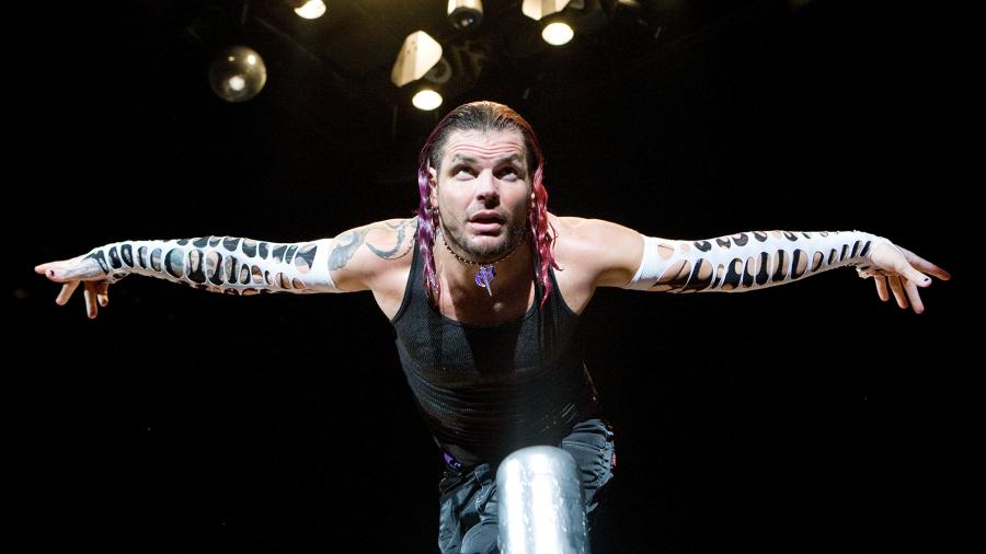 Jeff Hardy ties Matt Hardy to a table for a leg drop